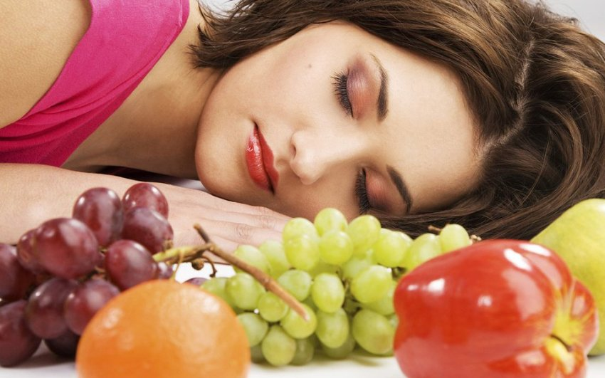 Fruits in front of a sleeping woman